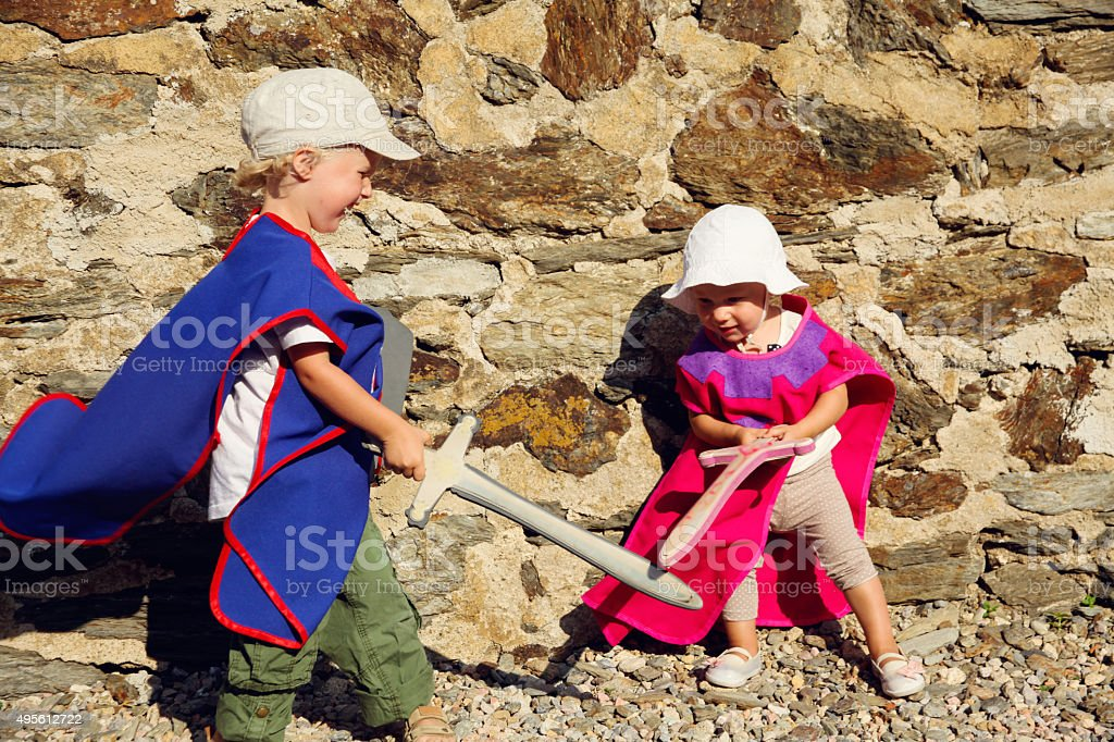 Children fight with swords in the castle stock photo