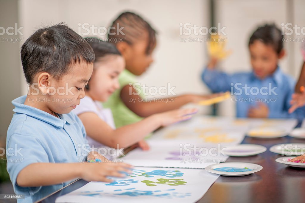 Children Finger Painting for an Art Project stock photo