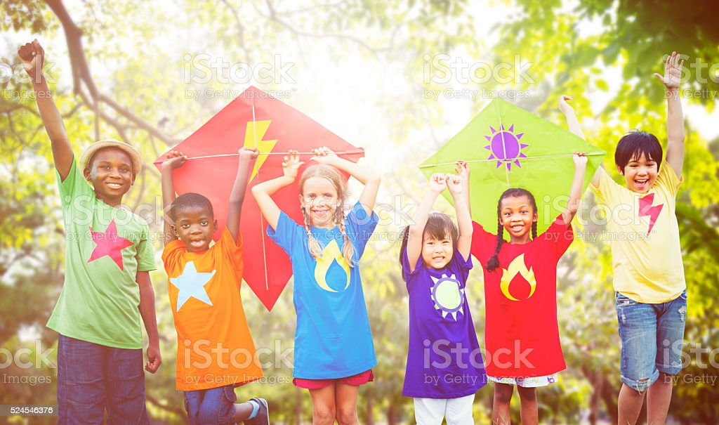Children Flying Kite Playful Friendship Concept stock photo