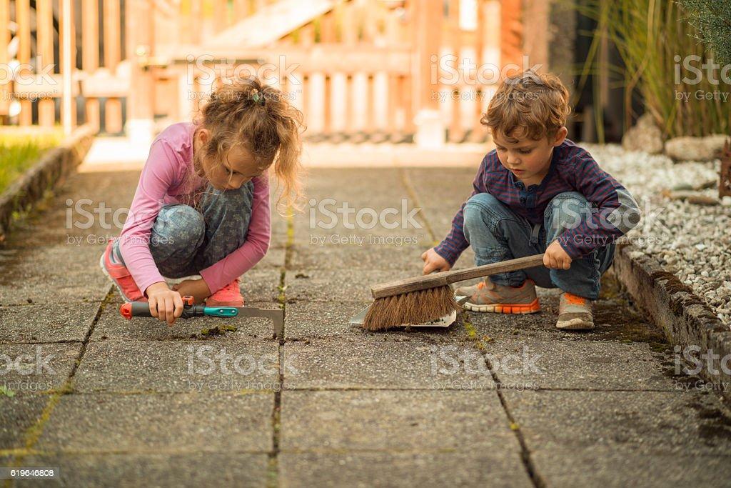 children garden work stock photo