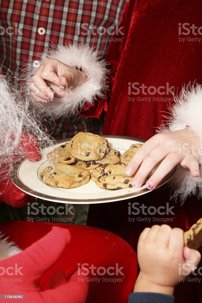 Children Gather Around Santa Claus To Have Cookies royalty-free stock photo