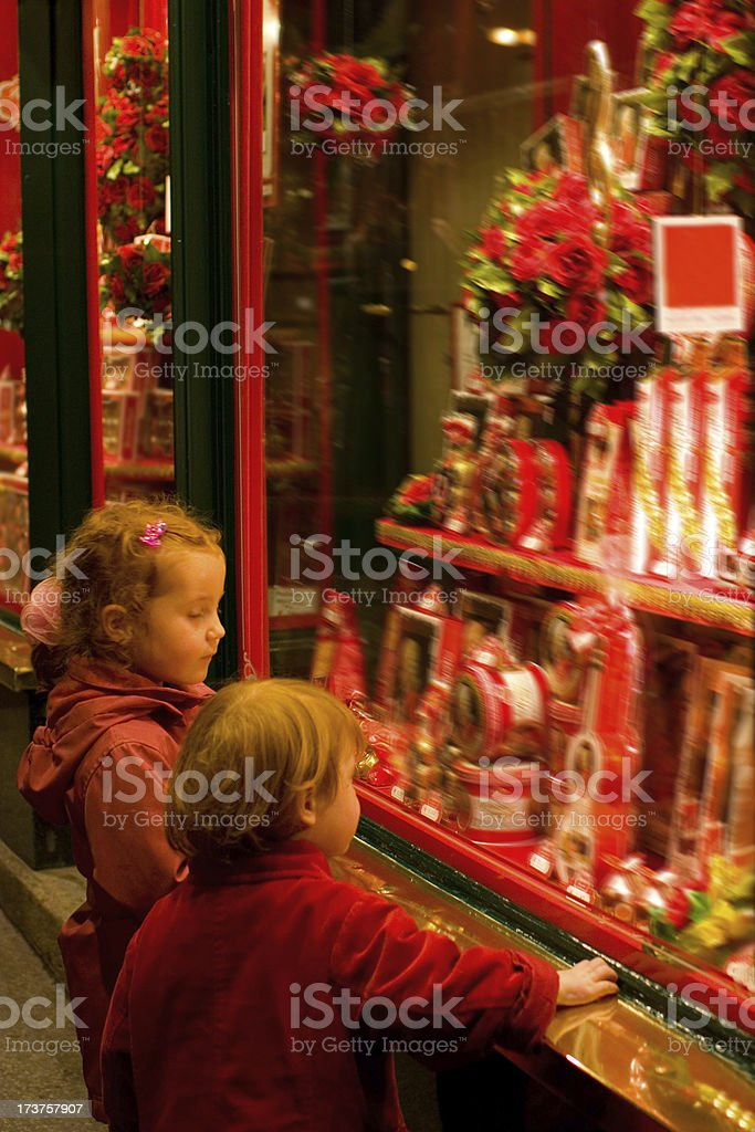 Children gazing at a candy shop window royalty-free stock photo