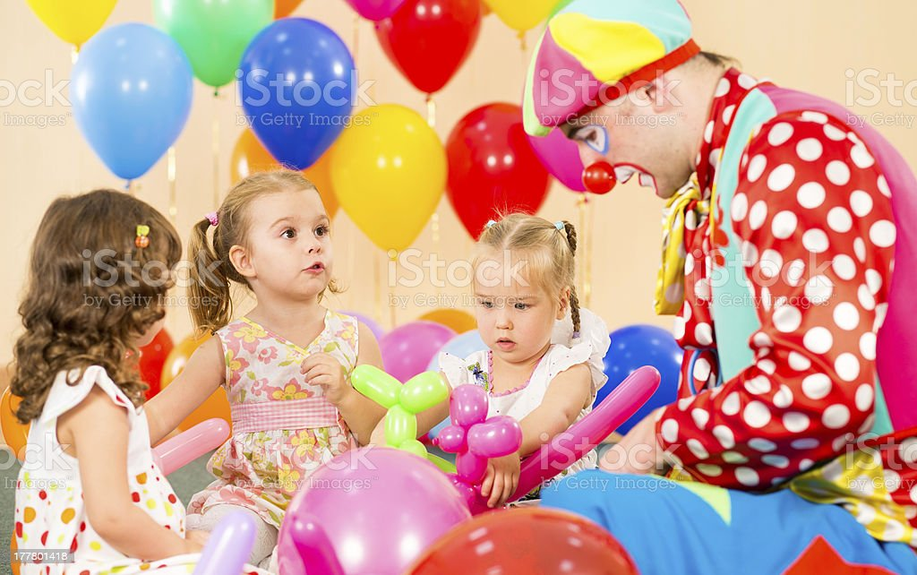 children girls and clown on birthday party royalty-free stock photo