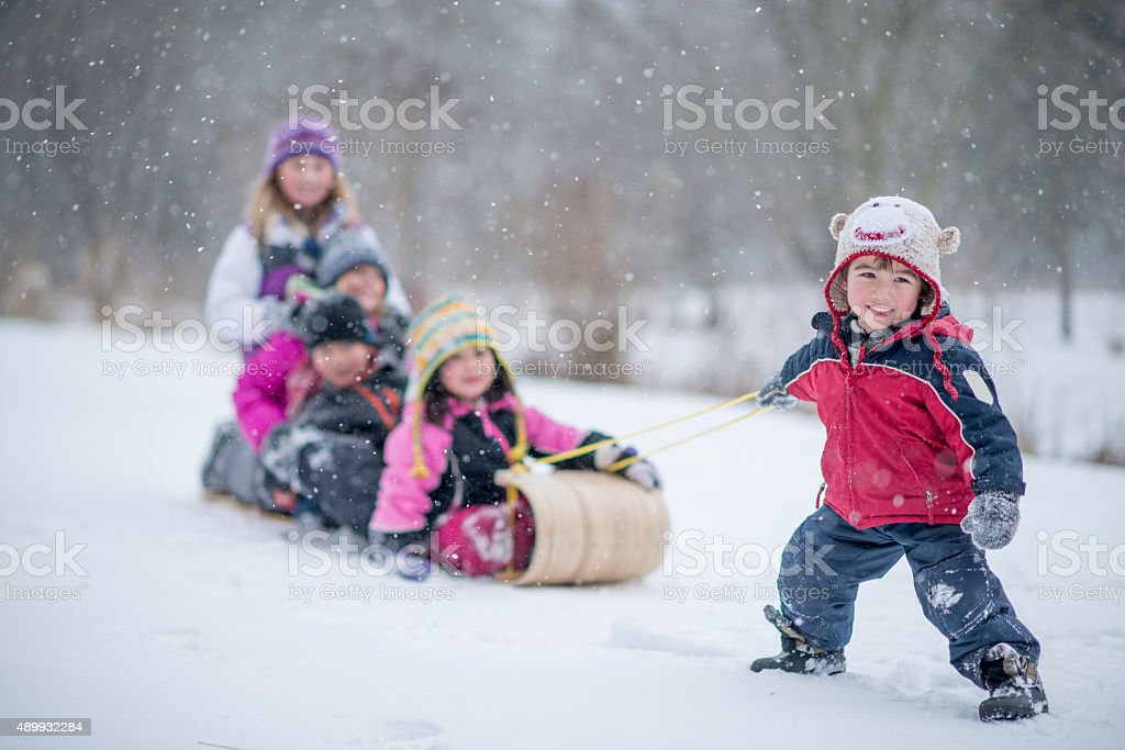 Children Going Sledding Together stock photo