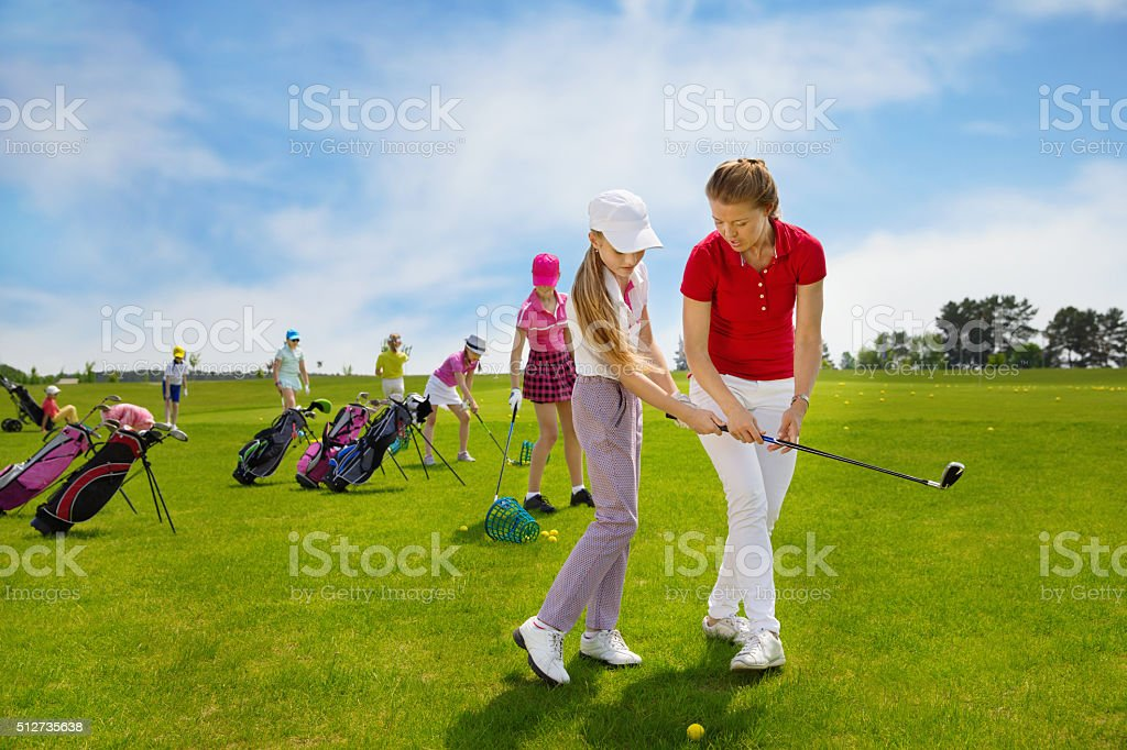 children golf school stock photo