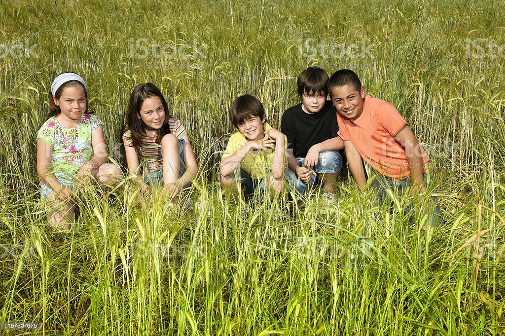 Children group, boys and girls,  enjoying nature royalty-free stock photo
