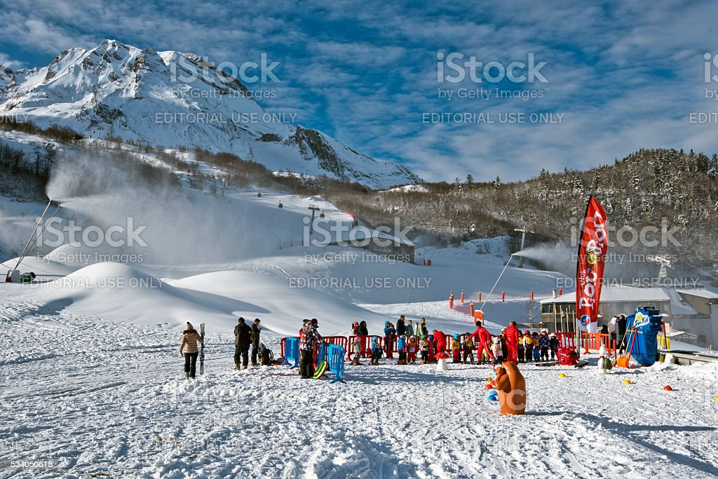 Children group in ski school in Gourette winter sport resort stock photo