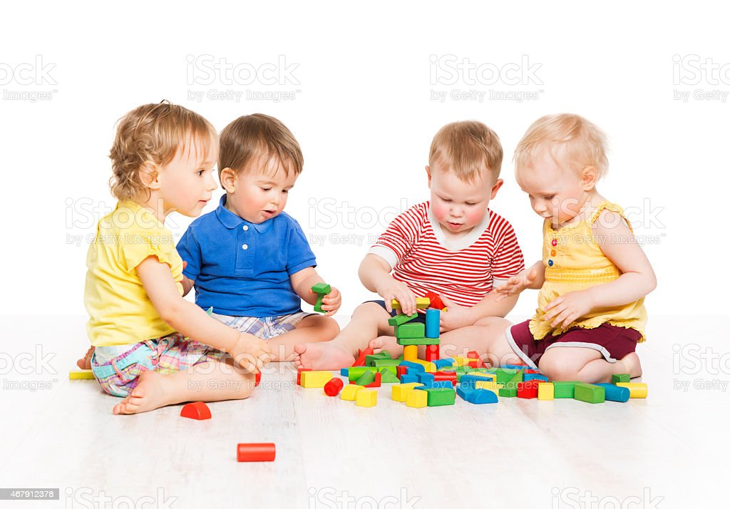 Children Group Playing Toy Blocks. Baby Little Kids Early Development stock photo