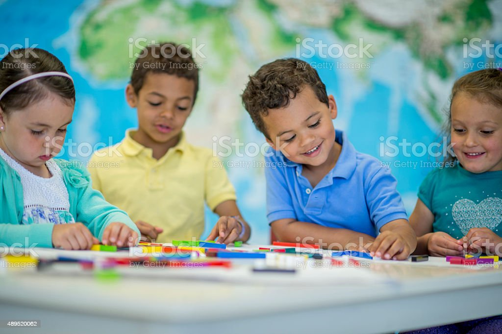 Children Grouping Blocks Together stock photo