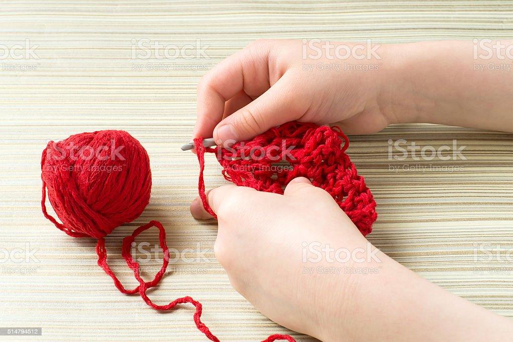 Children hand knit crochet stock photo