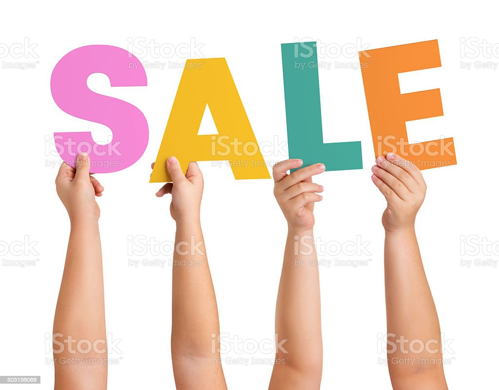 Children Hands holding the letters of the word SALE stock photo