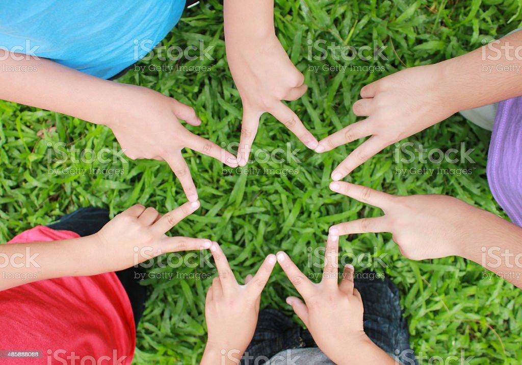 Kinder Hände mit Stern Lizenzfreies stock-foto