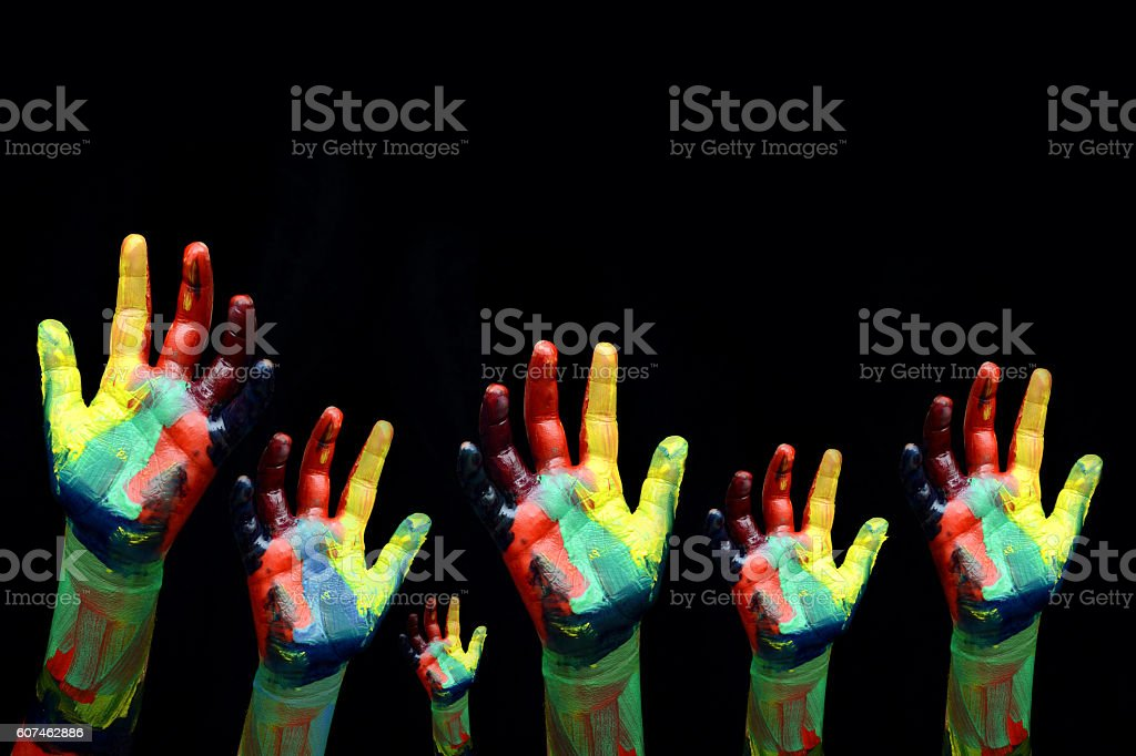 Children Hands seeking for Help SOS concept on black background stock photo