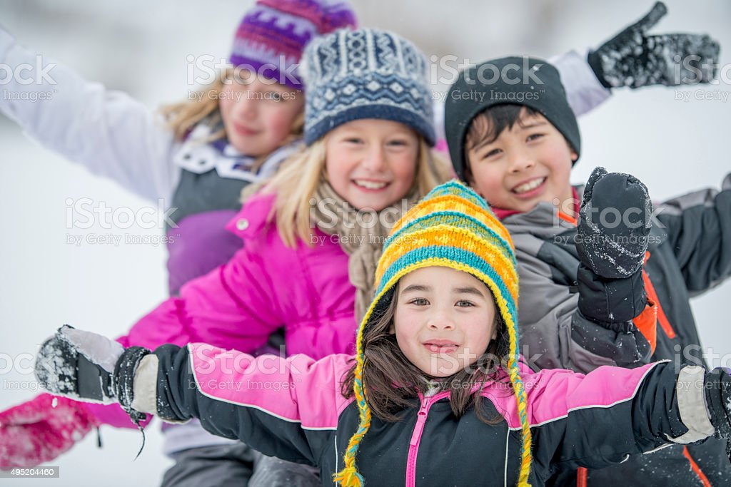 Children Happily Playing in the Snow stock photo
