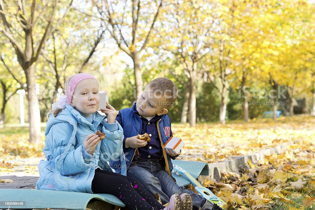 Children Having a Snack in Autumn Setting royalty-free stock photo