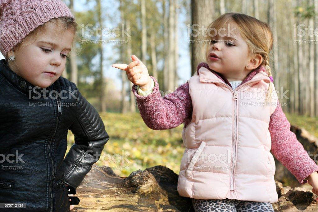 Children having an argument. stock photo