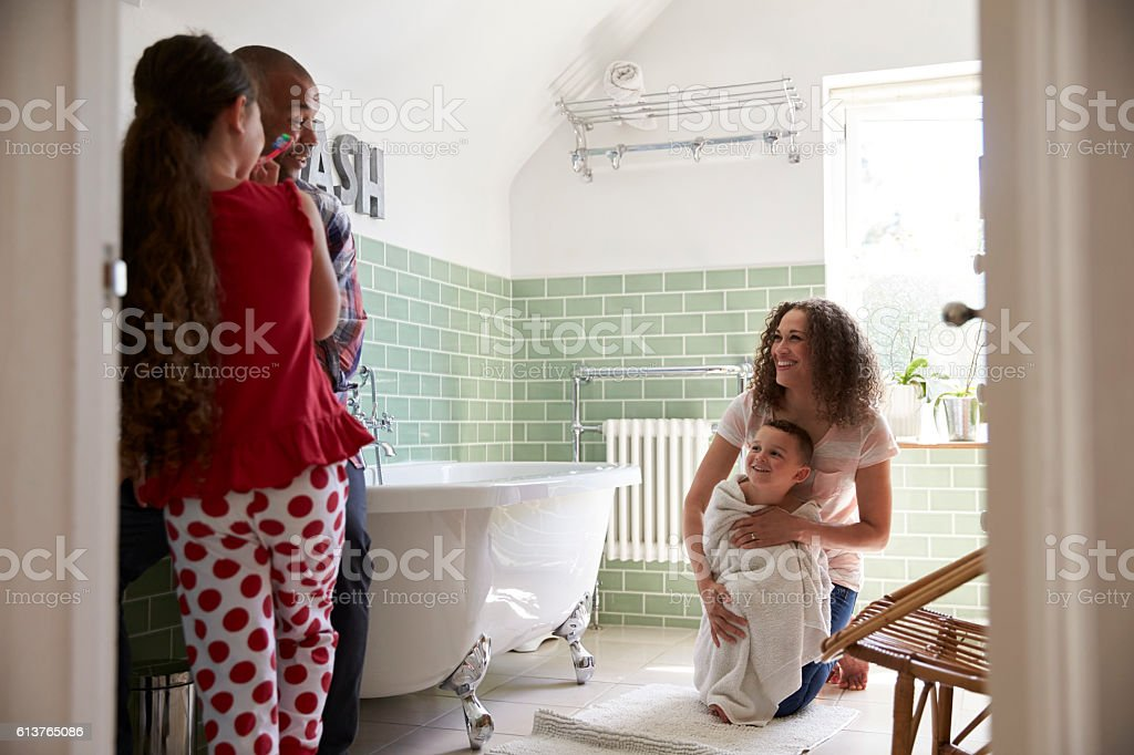 Children Having Bath And Brushing Teeth In Bathroom stock photo