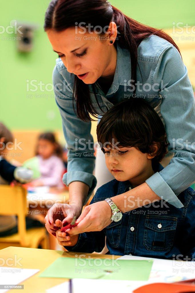 Children Having Creative Activity in Kindergarten. stock photo