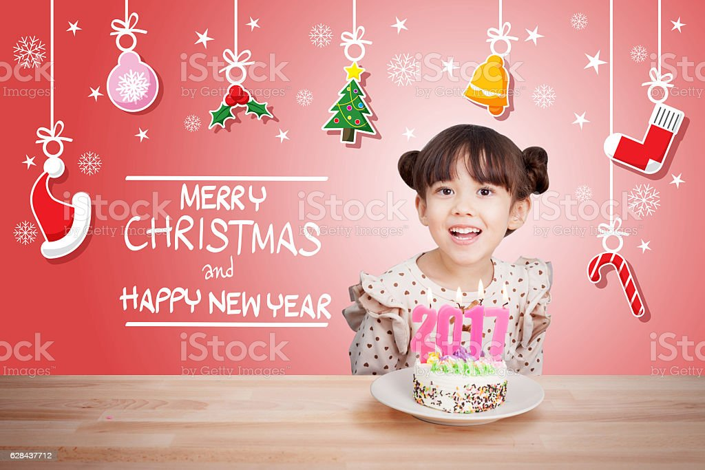 children having fun at new year party 2017 with cake stock photo