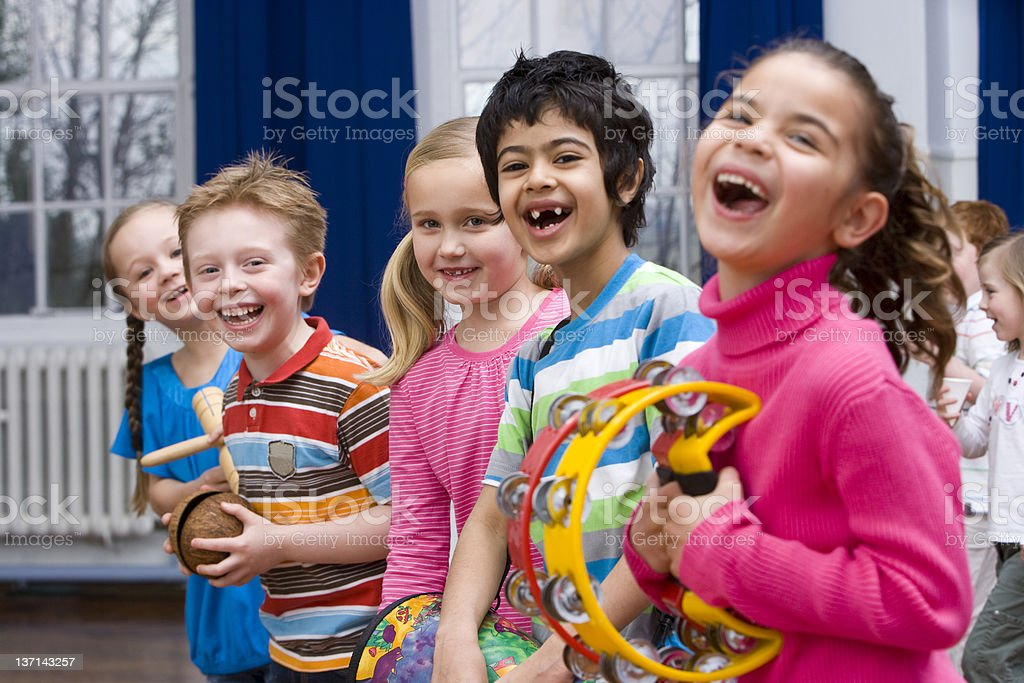 Children Having Fun in Music Class With Their Instruments stock photo