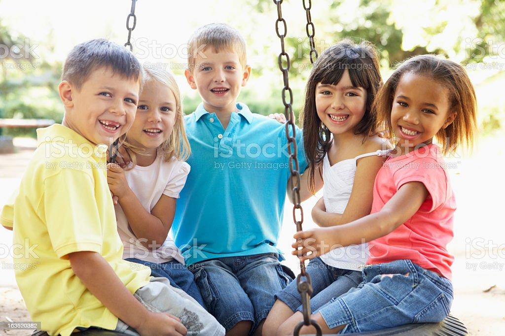 Children Having Fun In Playground Together stock photo