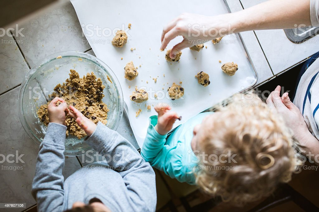 Children Helping Make Cookies stock photo
