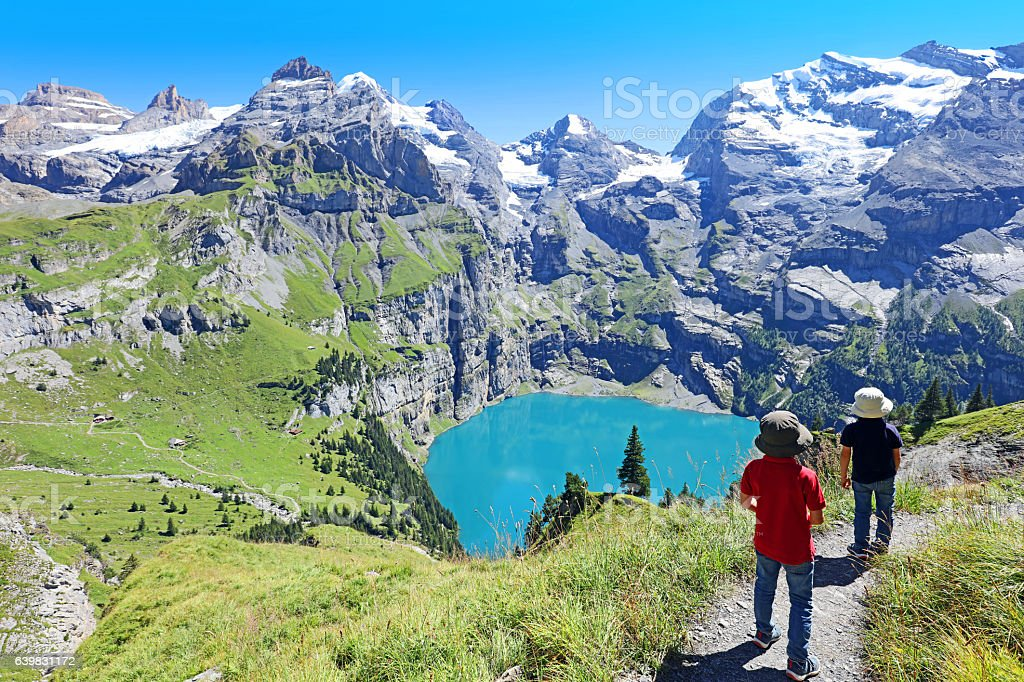 Children Hiking in the Swiss Mountains in Summer stock photo