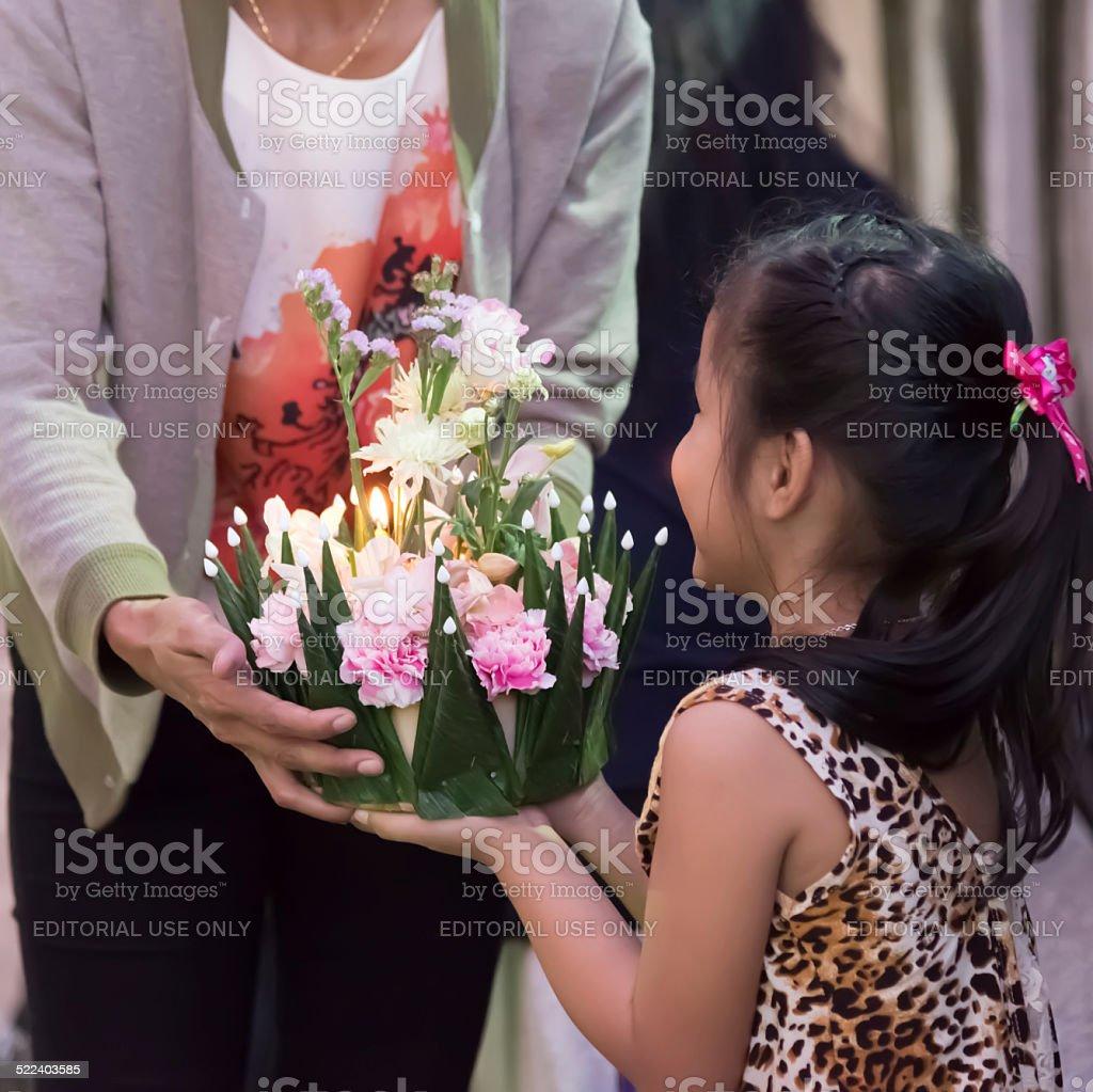 Children hold flora basket (Krathong) stock photo
