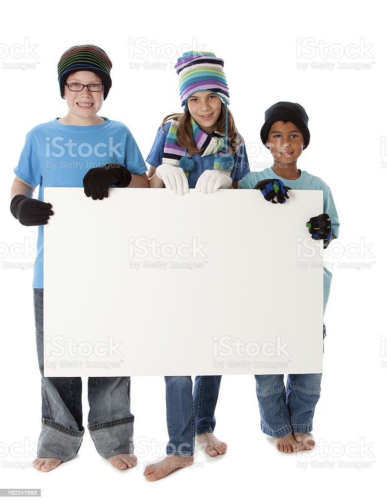 Children Holding Blank Sign for Cold Winter Season Holiday royalty-free stock photo