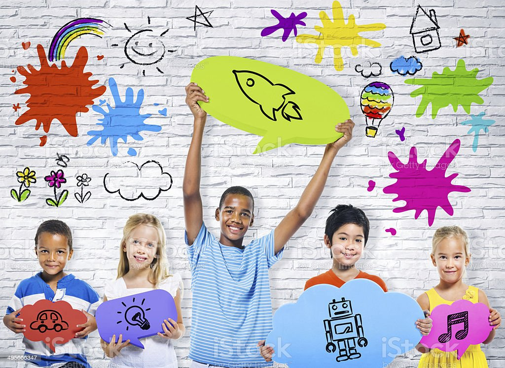 Children Holding Colourful Speech Bubble with Sign stock photo