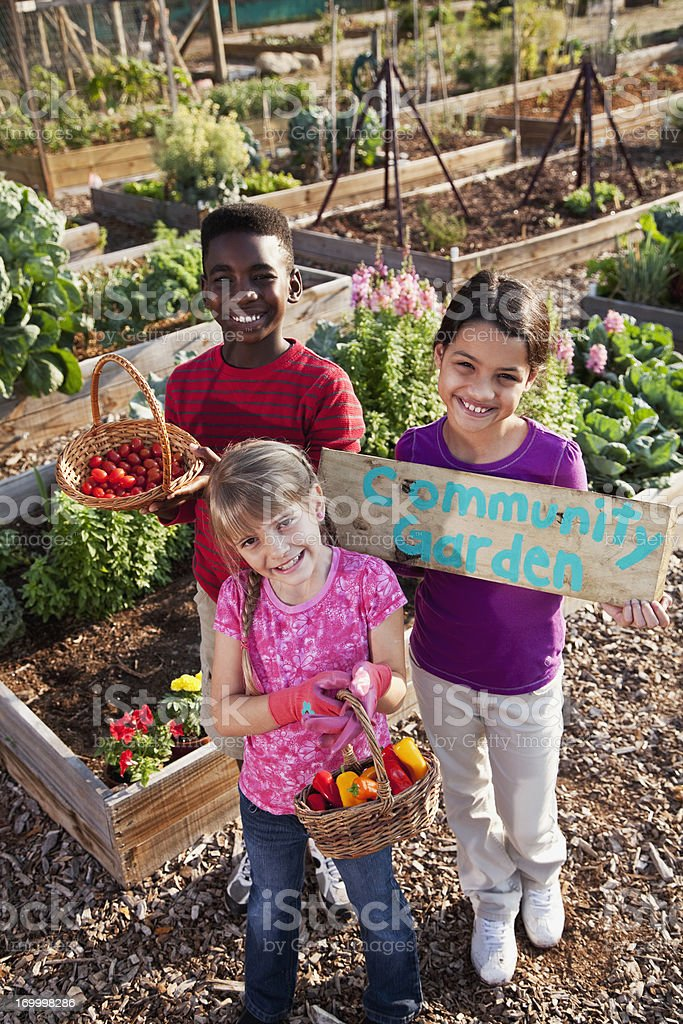 Children holding community garden sign royalty-free stock photo