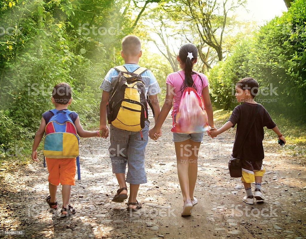 Children holding hands stock photo