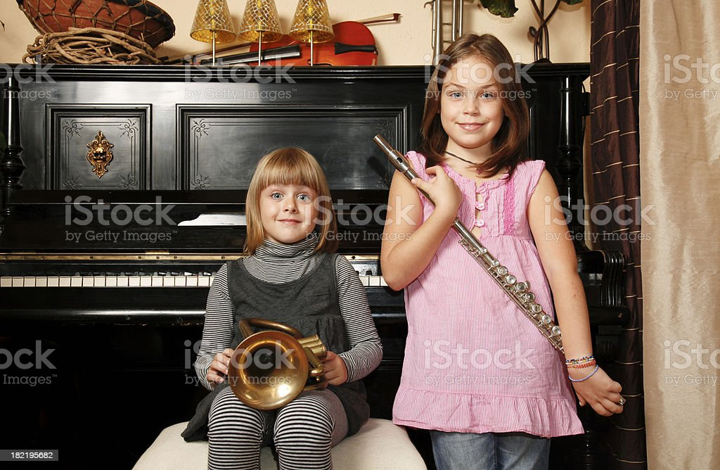 Children holding musical instruments stock photo