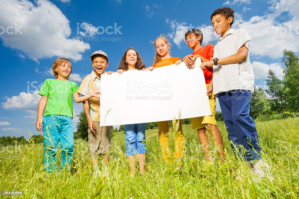 Children holding rectangular shape paper together stock photo