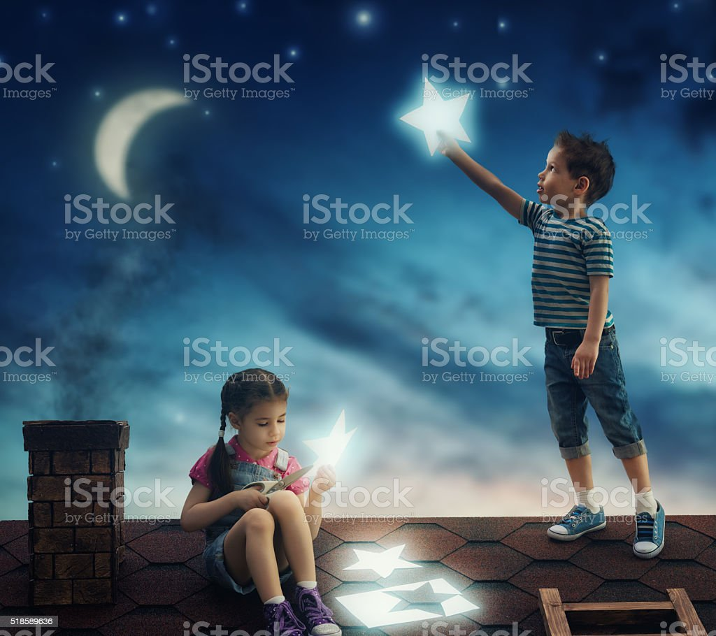 children hung the stars stock photo