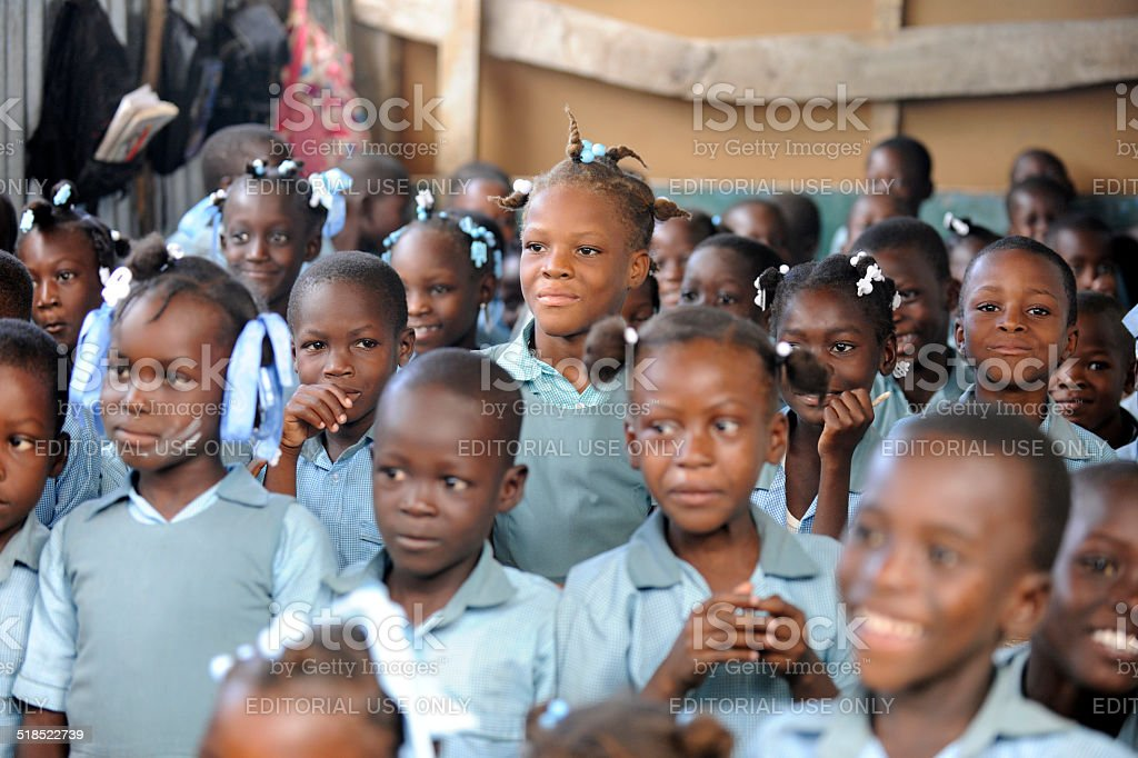 Children in a Crowded Haitian Classroom stock photo