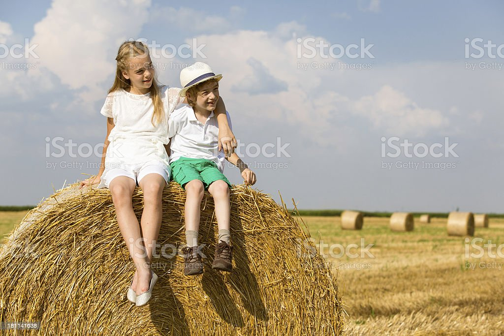 Children in a hay field royalty-free stock photo
