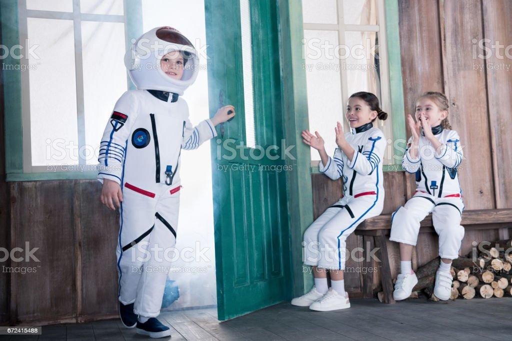 children in astronaut costumes stock photo