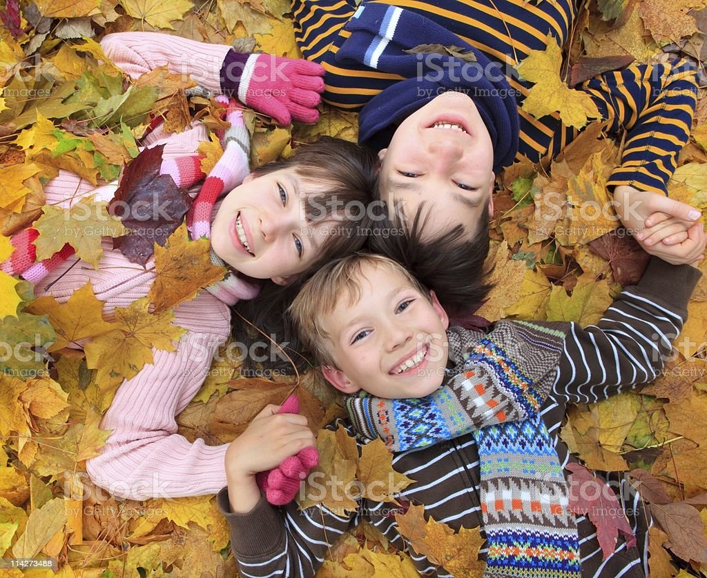 Children in autumn leaves royalty-free stock photo