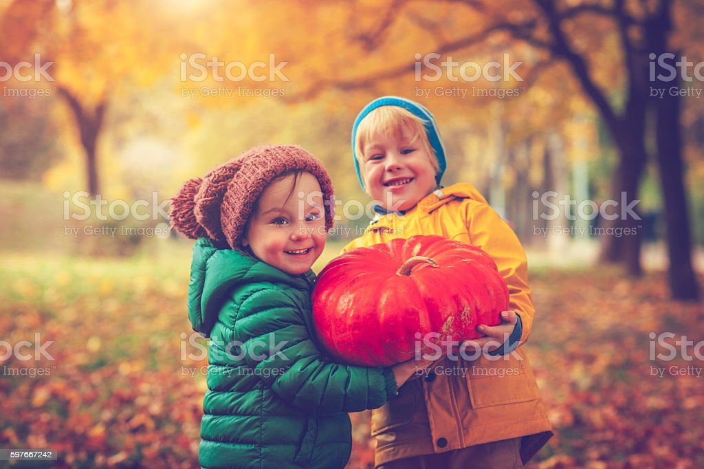 Children in autumn park at Halloween stock photo