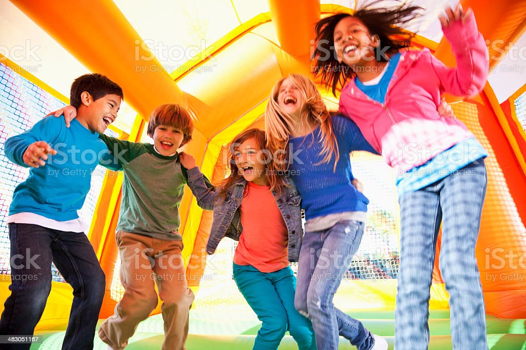Children in bounce house stock photo