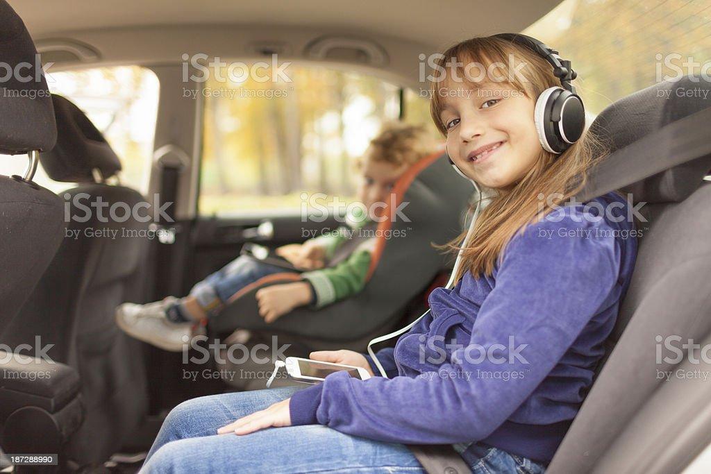 Children in car seats stock photo