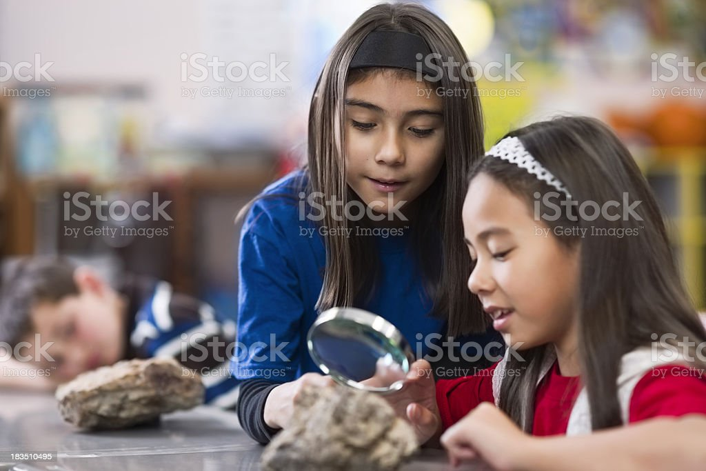 Children in Classroom With Magnifying Glass royalty-free stock photo