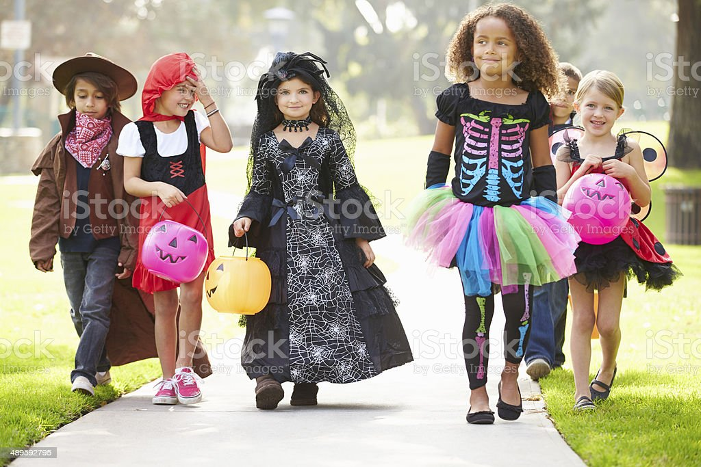 Children In Fancy Costume Dress Going Trick Or Treating stock photo