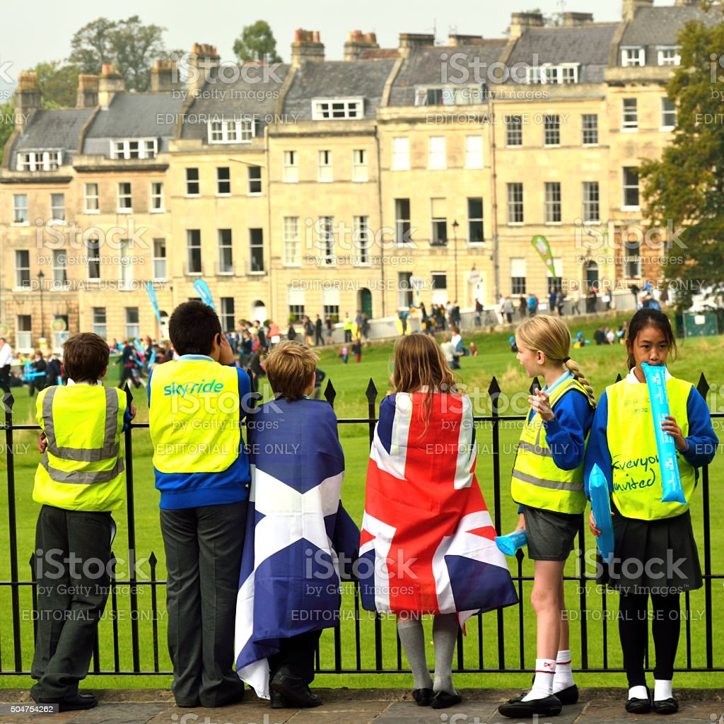 Children in flags watching Tour of Britain stock photo