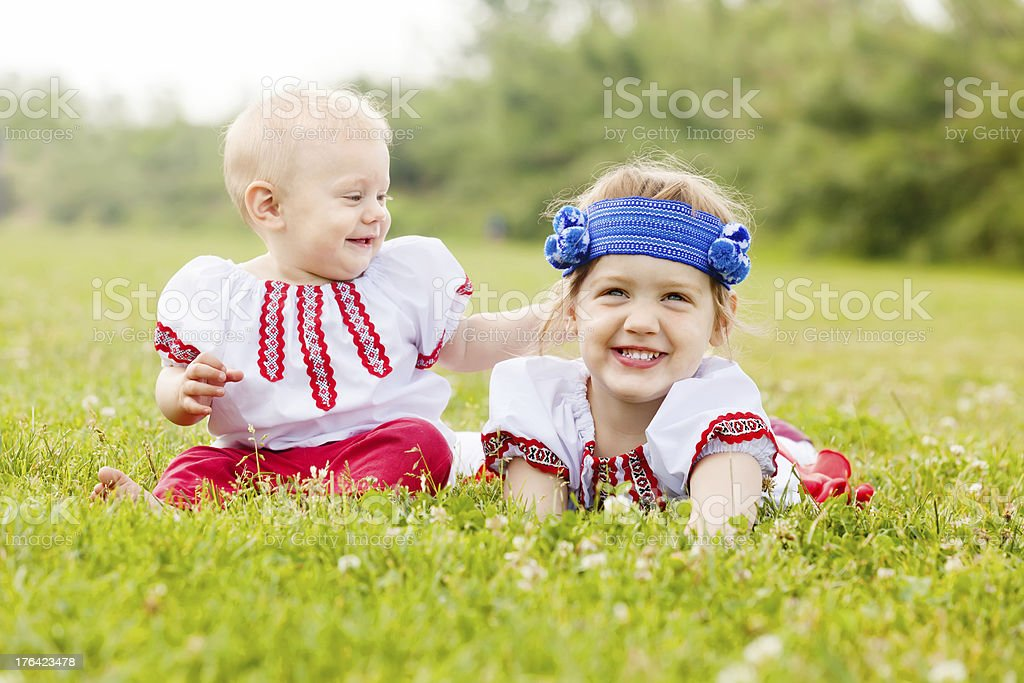 children in  folk clothes stock photo