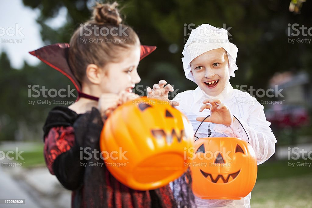 Children in halloween costumes stock photo