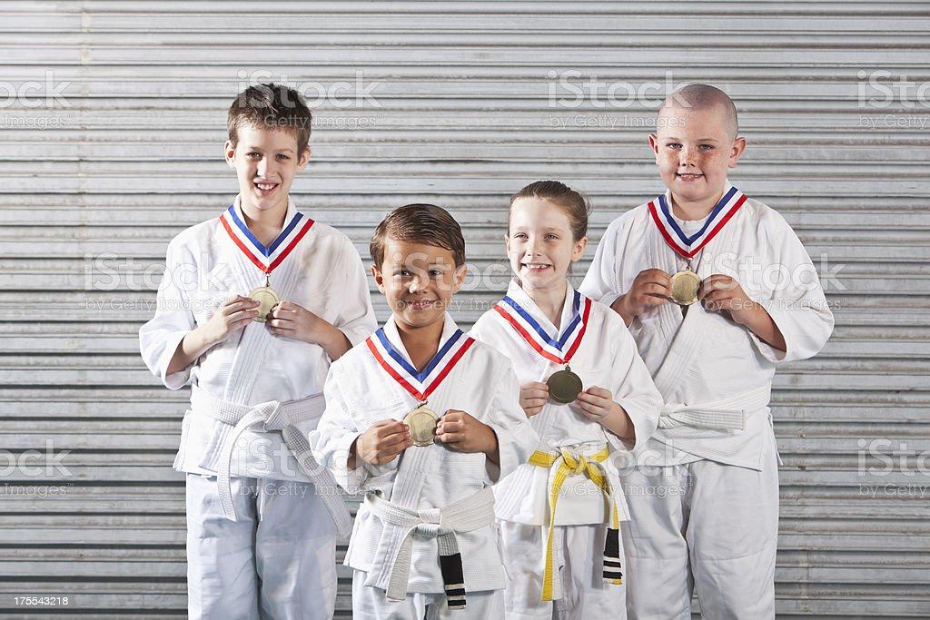 Children in Jiu-Jitsu uniforms, wearing medals royalty-free stock photo