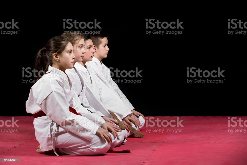 Children in kimono sitting on tatami. stock photo