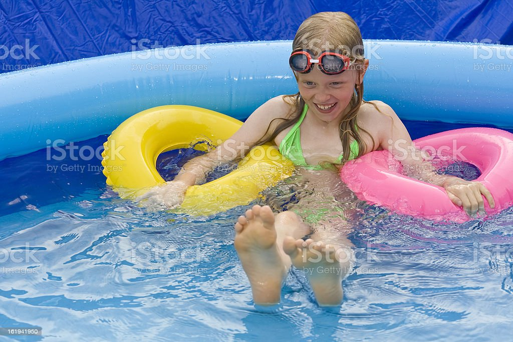 Children in paddling pool royalty-free stock photo
